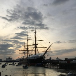 HMS Warrior with freighter in the background.