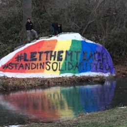The rock by Walton Pond was painted with the rainbow and the hashtags #LetThemTeach and #StandInSolidarityEU to express solidarity with the LGBT+ community on Eastern's campus.
